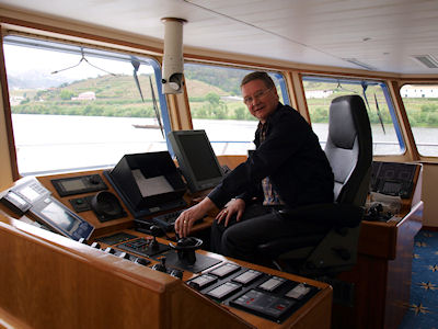 Captain Halling at the helm
